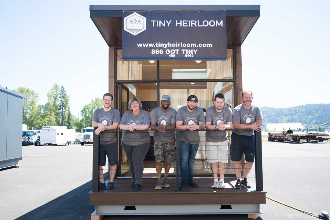 The Tiny Heirloom Team in front of an eXpanse Tiny Home